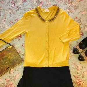 Yellow Kate Spade cardigan with gold baubles